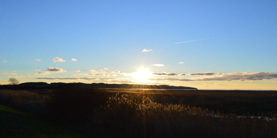 Sonnenuntergang über der Halbinsel Mönchgut in der Nähe der Ferienwohnung im Ostseebad Göhren auf Rügen
